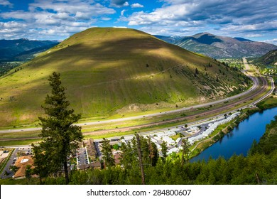 View of a large hill and the Clark Fork River, in Missoula, Montana.