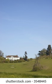A view of a large house on top of a hill