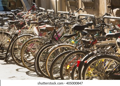 View of large number of Bicycles in racks on a sidestreet of Florence
