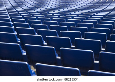 View of a large number of stadium blue seats.