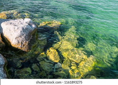 The view of large rocks in Egirdir Lake of Isparta.  Transparent lake water.