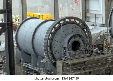 View of the large sag and ball mill in the mine factory. A ball mill is a type of grinder used to grind and blend materials for use in mineral dressing processes.