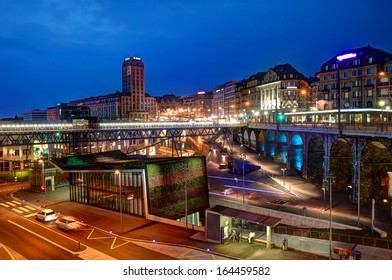 View of Lausanne downtown (Lausanne-Flon) at the blue hour in Switzerland. In front we have the new metro station covered with colorful grass.
