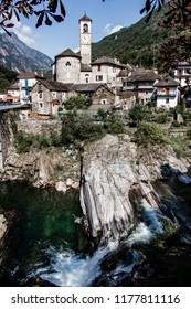 View to Lavertezzo village in Valle Verzasca, famous Swiss village with double arch stone bridge at Ponte dei Salti with waterfall, Lavertezzo, Verzascatal, Canton Tessin – Tecino