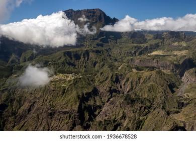 View from the Le Maido lookout in the Cirque de Mafate with Piton des Neiges vulcano, below La Nouville, La Reunion