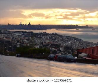 view of lebanese mediterranean coast, jounieh, Kaslik and Beirut cityscape in background at dusk