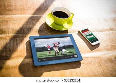 View of lecture app against cup of coffee and tablet pc