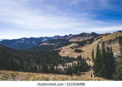 View of a ledge overlooking a valley in the Bridger-Teton National Forest in Jackson Wyoming on a sunny day