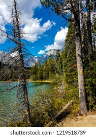 A view from the Leigh Lake Trail in Grand Teton NP in Wyoming, promises spectacular beauty. This view of the lake and Teton peak was shot from the trail through a small opening in the woods.