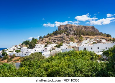 View of lemon trees and Acropolis of Lindos (Rhodes, Greece)