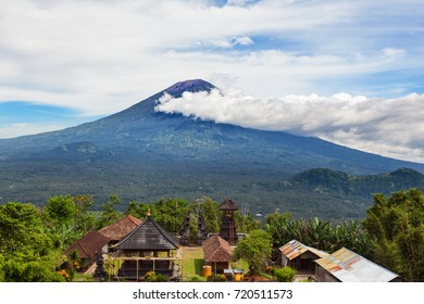 View from Lempuyang mountain to traditional Balinese temple on Mount Agung background. Mount Agung is popular tourist hiking route and highest active volcano on Bali island, Indonesia.