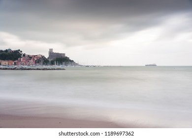 A view of Lerici (La Spezia), a famous sea turistic destination in Liguria (Italy) at sunset withcloudy sky.