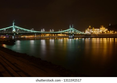 View of the Liberty bridge at Budapest, Hungary at night with beautiful lighting