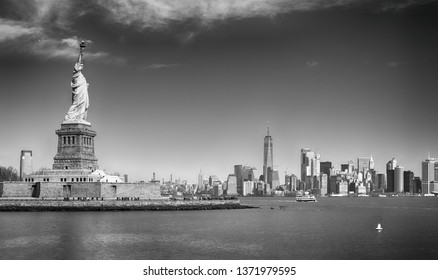 View of Liberty Island with Statue of Liberty and Manhattan.