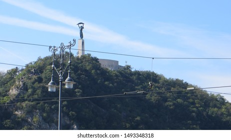 View of Liberty Statue of The Citadella on top of Gellert Hill in Budapest, Hungary. Citadella is the Hungarian word for citadel, a kind of fortress, held strategic importance in military history.
