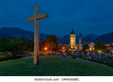 View of Liebfrauenkirche and town and surounding mountains at dusk, Kitzbuhel, Austrian Tyrol, Austria, Europe 1-5-2019