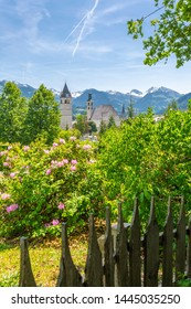 View of Liebfrauenkirche and town and surounding mountains, Kitzbuhel, Austrian Tyrol, Austria, Europe 1-5-2019