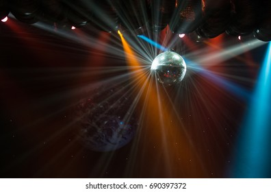 View of light beams reflecting from a disco ball.