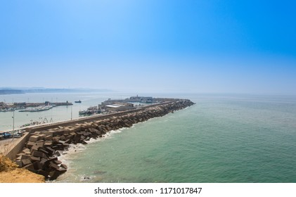 View from the lighthouse of Cape Roche of the nautical port and its breakwater, in Conil, Andalucia. Spain