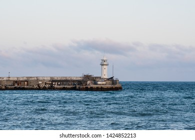 view of the lighthouse in the city of Yalta, the embankment of Yalta, the Crimean herjazhi, the Black Sea in Yalta, the Yalta lighthouse