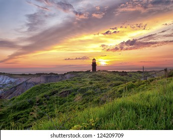 View of a lighthouse with colorful sky n the background.