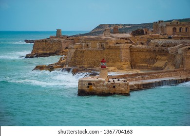 View of the lighthouse in the fort Rinella seen from fort Elmo, war museum in Valletta, Malta island February 2019
