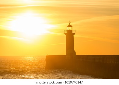 View of lighthouse at sunset. Porto, Portugal