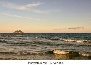 View of the Ligurian Sea with the Gallinara Island on the horizon at sunset, Alassio, Liguria, Italy