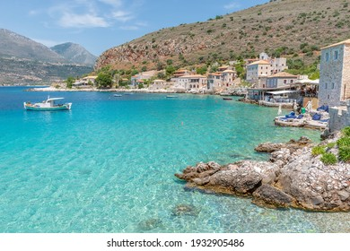 view of  Limeni village with fishing boats in  turquoise waters and the stone buildings as a background  in Mani, South Peloponnese , Greece.
