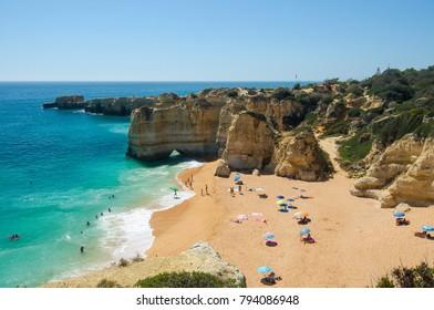 View of limestone cliffs and the Rabbit Beach (Praia da Coelha) in Albufeira, District Faro, Algarve, Southern Portugal