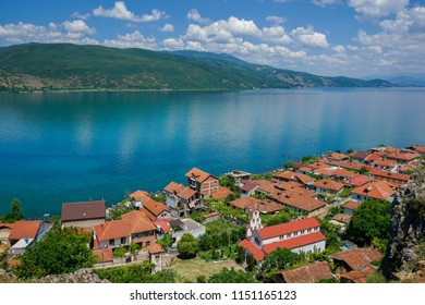View of Lin village in Albania and Ohrid Lake from above. Beautiful sky and blue water.