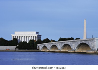 View of the Lincoln Memorial, Washington Monument and Memorial Bridge from the banks of the Potomac River.