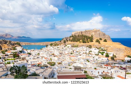 View of Lindos village with Acropolis and Mediterranean Sea in background (Rhodes, Greece)