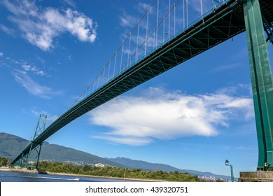 View of the Lions Gate Bridge from the Stanley Park Seawall Vancouver British Columbia Canada.