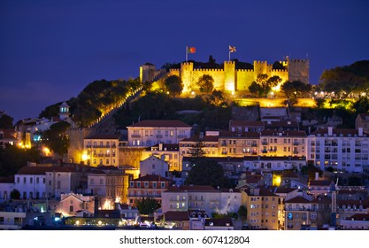 View of Lisbon in the night with St Jorge Castle on the hill