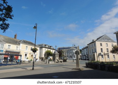 A view of Liskeard town square in Cornwall, with the celtic cross and monument