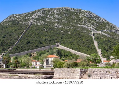 View to the little village Ston and the Walls. The Walls of Ston are a series of defensive stone walls, originally more than 7 kilometres long, that surrounded and protected the city.