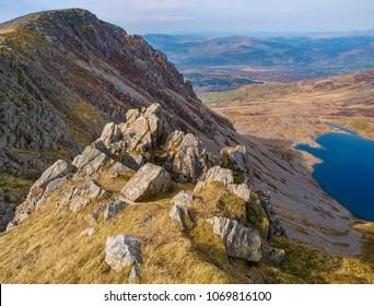 View of Llyn y Gader from a rocky outcrop on Cader Idris mountain in Snowdonia National Park, Wales, UK