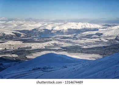 View of the Loch Lochy and scottish mountains during winter in Nevis Range, Scotland.
