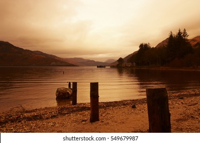 VIEW OF LOCH LOMOND AT TWILIGHT WITH MIST ON DISTANT HILLS FROM ROWARDENNAN LODGE STIRLING SCOTLAND