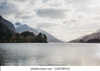 View of the Loch Shiel and Scottish landscape near Glenfinnan, Inverness-shire, Scotland, on a cold spring sunny day.