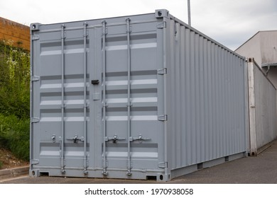 view of a locked shipping container of goods on the street