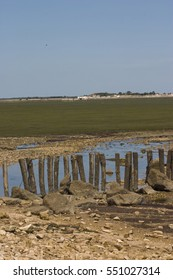 View to Loix on Il de Re through marshes and breakwaters,