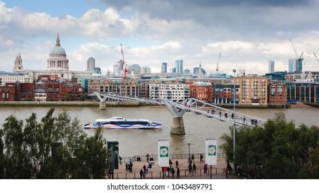 a view of London city skyline on thames with Millennium bridge
