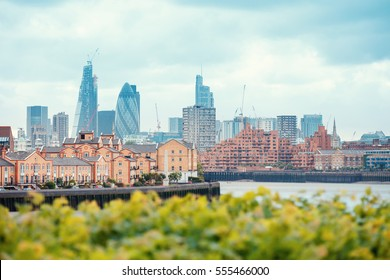 View of London Docklands with the Thames River, downtown, cucumber and city center. Real estate buildings suburbs