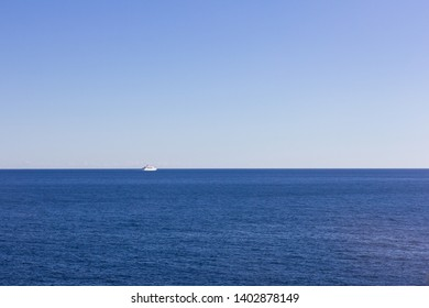 View of a lonely transatlantic sailing towards the horizon of the Mediterranean Sea on a beautiful sunny day