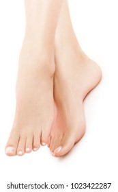 View of long smooth woman's legs on white background with a helthy pedicure. High resolution photograph suitable for print or web use.
