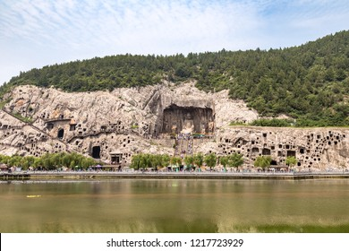 View of Longmen Grottoes complex in Luoyang, Henan, China. Fengxiangsi Cave is the main one in the Longmen Grottoes. Longmen is one of the 3 major Buddhist caves of China, and a World heritage Site.