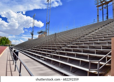View looking across stadium bleachers with blue sky and clouds