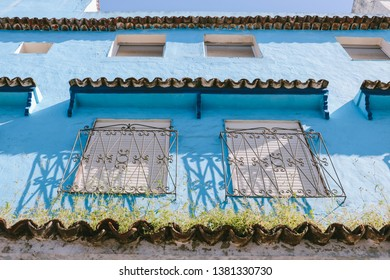 View looking up from an alley in the medina of Chefchaouen, northwest Morocco. The town is famous for its buildings in shades of blue.